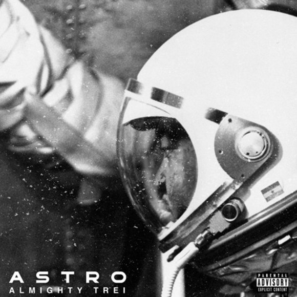 Black and white photo of a man wearing an astronoaut outfit with the words Astro at the bottom right corner